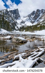 Spring Dream Lake - A wide-angle vertical view of still-mostly-frozen Dream Lake, with Hallett Peak and Flattop Mountain towering at shore, Rocky Mountain National Park, Colorado, USA.