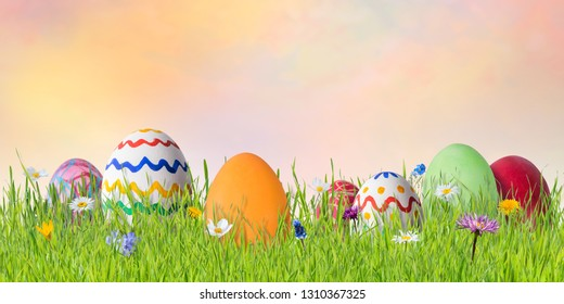 Spring easter background with painted eggs and flowers. Holiday wallpaper