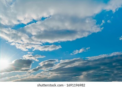 Spring evening sky in the picturesque clouds, lit by the rays of the setting sun. - Shutterstock ID 1691196982