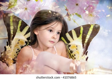 Spring fairy on pink blossom chery tree
