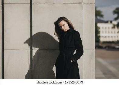 Spring fashion style. Woman wearing black coat