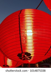 spring festival of modern china or traditional Chinese new year, red hanging lanterns festival with clear evening sky in Chinese old shrine at Bangkok Thailand, outdoor no people low angle view