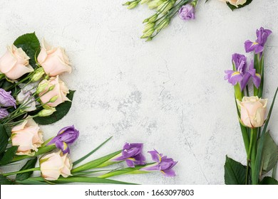 Spring. Flat lay flowers. Layout, top view in the shape of a heart. The concept of spring. White background. Roses, irises, lilac, purple. Place for text. Copy space