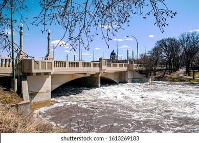 Spring flood of Wascana creek under  the Albert Memorial Bridge (Regina, Saskatchewan)
