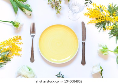 Spring floral table settings with spring flowers. Top view empty plate. Flat lay card. Copy space