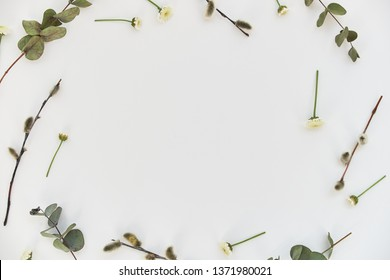 Spring flower arrangement on a white background with place for text, top view. Florals frame