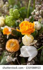 Spring flower arrangement in orange and white colors.
