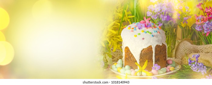 Spring flower banner background with Easter eggs. Easter holiday creative background banner.  Happy Easter concept.  Table decorating for Easter holiday. Copy space for your text