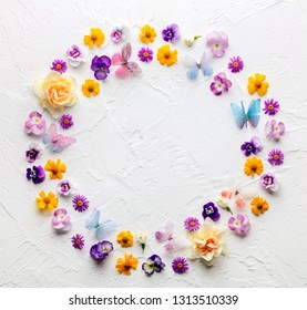 Spring flower flatlay on white background