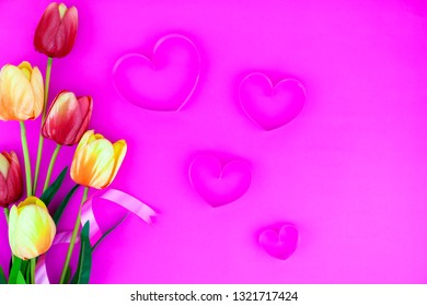 Spring flower of multi color Tulips on pink background ,Flat lay image for holiday greeting card for Mother's day,Valentine's day, Woman's day and copy space space for your text.