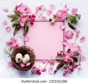 Spring flowers and easter eggs with blank card