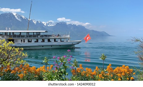 Spring flowers and ferry in lake in Montreux, Switzerland