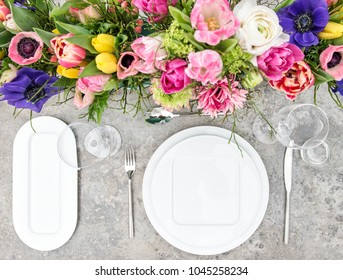 Spring flowers. Festive place setting with floral decoration