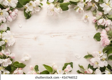 Spring flowers frame on wooden background