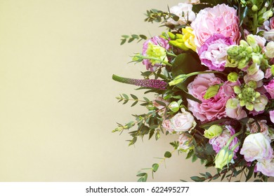 Spring flowers: freesia, paasentia, eustoma, roses, eucalyptus, fern in beautiful bouquet