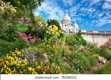 Spring flowers in the garden in front of Sacre Coeur Cathedral in Paris, France