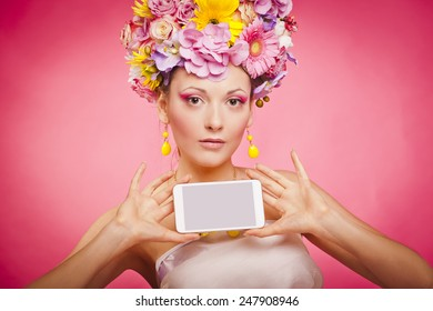 Spring flowers girl is holding smartphone in hands