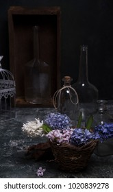 spring flowers and glass bottles