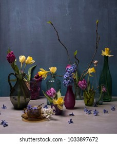 spring flowers and glass bottles on the table
