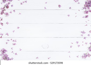 Spring flowers . Lilac flowers on white wooden background. Top view, flat lay.