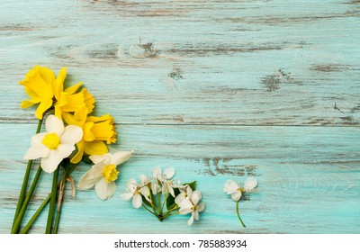 Spring flowers  . Narcissus on a wooden background. The concept of the beginning of the day
