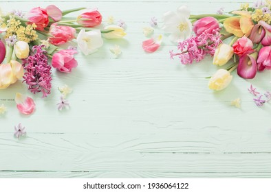 spring flowers on green wooden background
