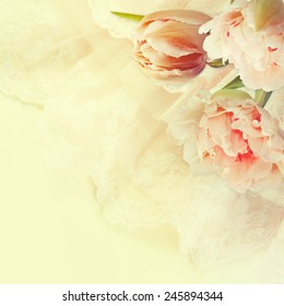 Spring flowers on the lace background.