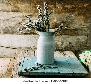 Spring flowers on wood. Rustic spring setting. Willow flowers on spring table setting.Spring decoration