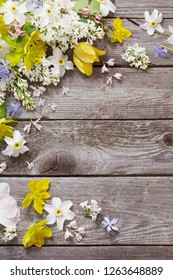 spring flowers on wooden background