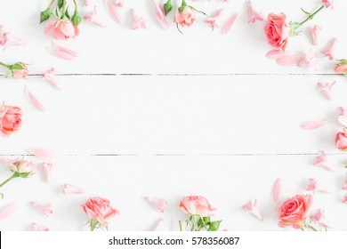 Spring flowers. Pink flowers on white wooden background. Flat lay, top view