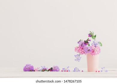 spring  flowers in vase on white table