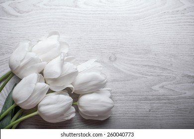 spring flowers white tulips bouquet on wooden background present for holidays mother day easter valentines wedding
