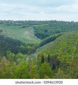 Spring forest, ravine and village view from Jazlovets castle ruins, Buchach District, Ternopil Region, Ukraine.