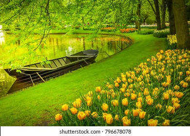 spring garden with canal and boat, 'Keukenhof', Holland, toned