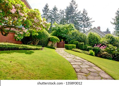 Spring garden and pathway near home. American Northwest. End of May.