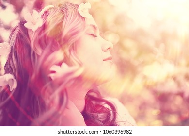 spring girl apple flowers, nature portrait of happy girl with long hair in blooming apple trees, freedom purity concept of happiness