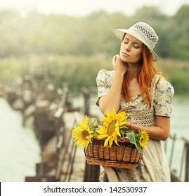 Spring girl and sunflowers.