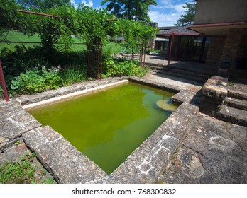 Spring Green, Wisconsin, USA - July 2, 2017: Frank Lloyd Wright's home named Taliesin included a splash pool just outside the famous architect's bedroom.