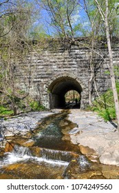 Spring at the historic Sawmill Branch Viaduct, a stone bridge for the railroad and a underpass for a creek. Located along the Grist Mill Trail at Patapsco Valley State Park in Elkridge, Maryland.
