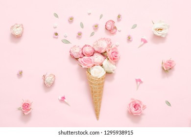 Spring holiday present. Conceptual rose bouquet on festive pink background.