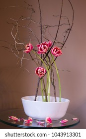 Spring Ikebana with pink tulips