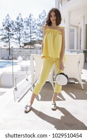 Spring image of young elegant student,teenager lady,suit and bag,heels shoes,morning breakfast,at cafe,volume hair,weekend outfit,spring outfit,round clutch bag,woman lifestyle,waiting friends