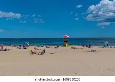 SPRING LAKE, NEW JERSEY - JUNE 22: People enjoy a beautiful beach day on June 22 2019 in Spring Lake New Jersey.