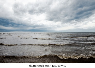 Spring landscape. Dark stormy sky over the Baltic sea, Latvia