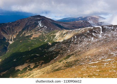 Spring landscape with the last snow in the mountains