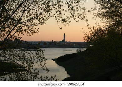 spring landscape mosque on the river bank at sunset