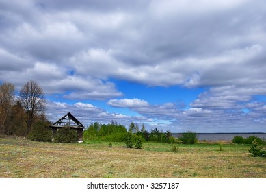 Spring landscape with and old ruined house