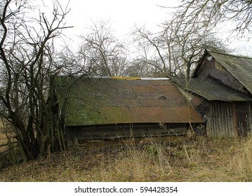 Spring landscape, old wooden house. Abandoned wooden house