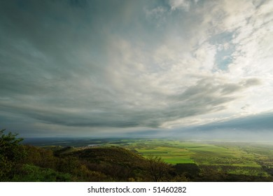 Spring landscape with rain clouds