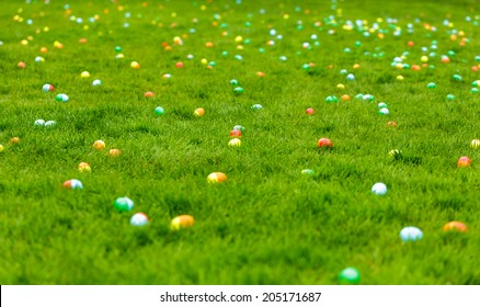 A spring meadow with Easter eggs hidden in the grass